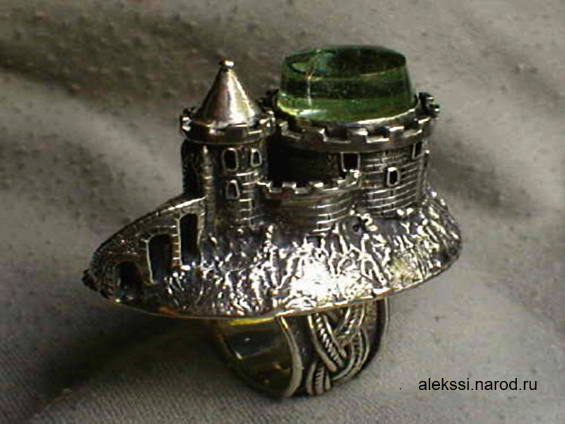 Silver ring in the form of old castle.