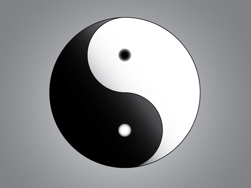 Изображение символа инь-яна на сером фоне.