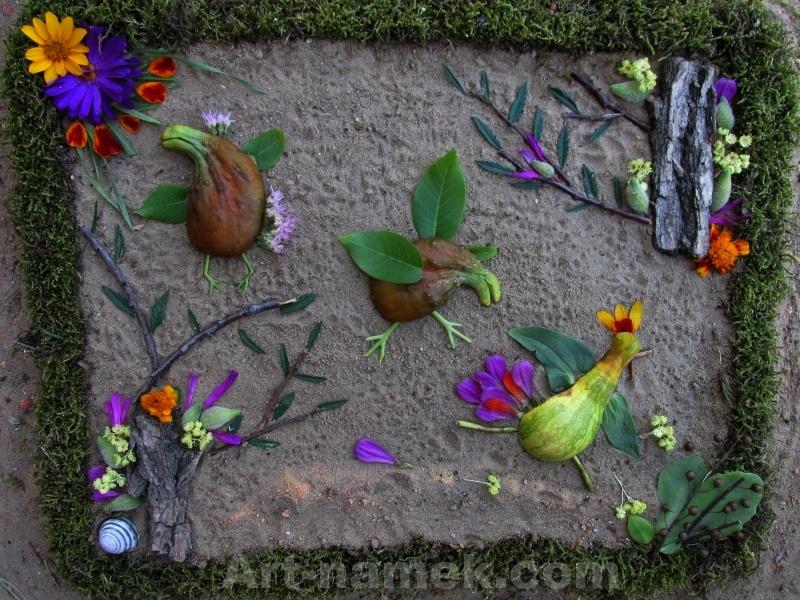 Забавная картинка из овощей (огурцы,  тыква) цветов, листьев.