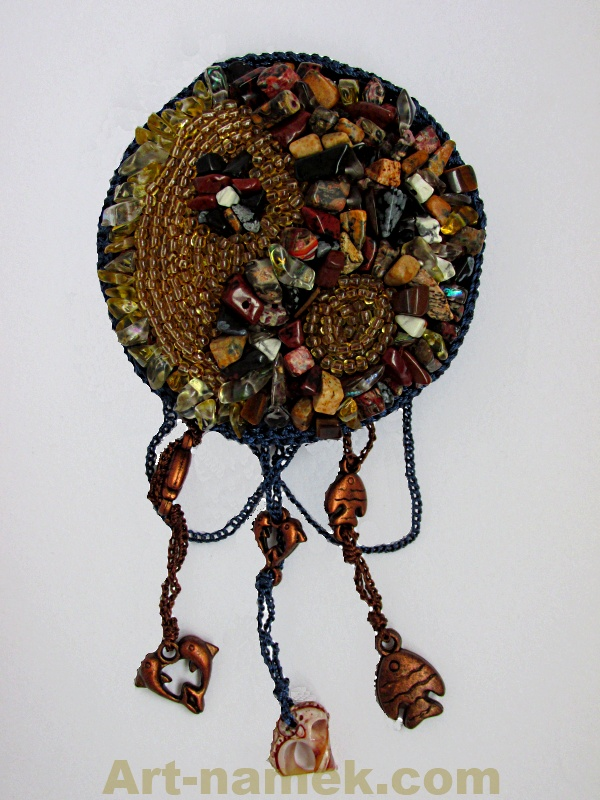 Handmade brooch having Yin - yang shape made of yellow breads that resembles stone.