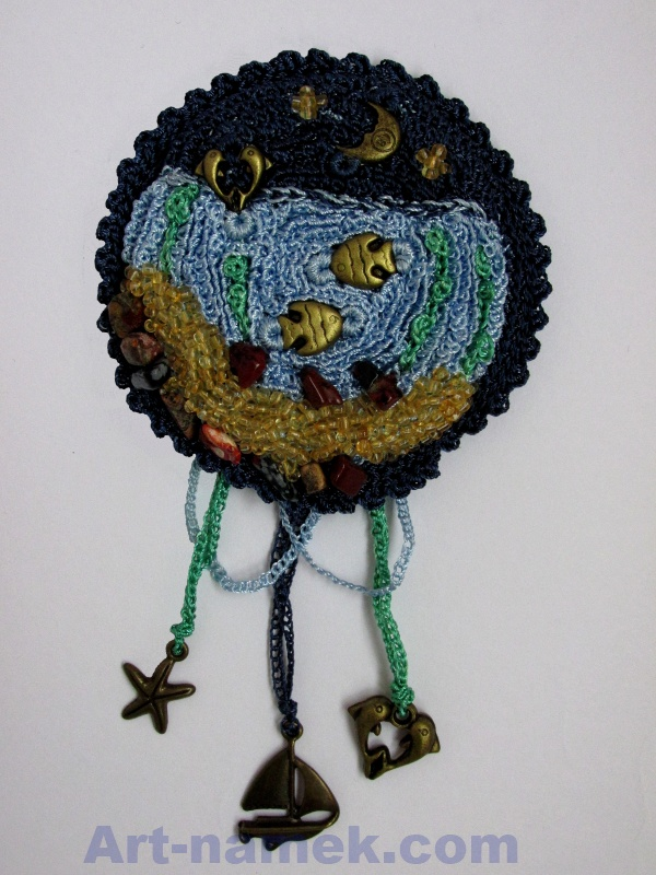 Handmade brooch with pendants made of threads and beads with seascape.